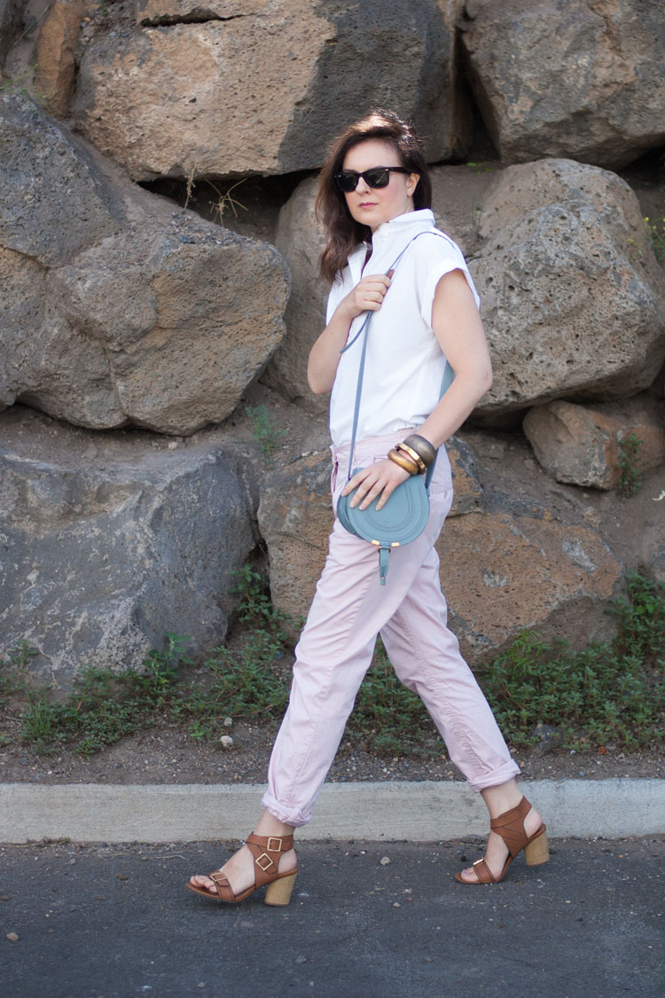 Fashion blogger street style. Summer work outfit. Chinos and a white shirt.