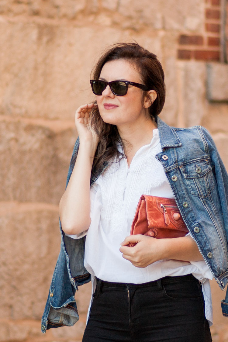Street style blogger white shirt denim jacket and a pink clutch