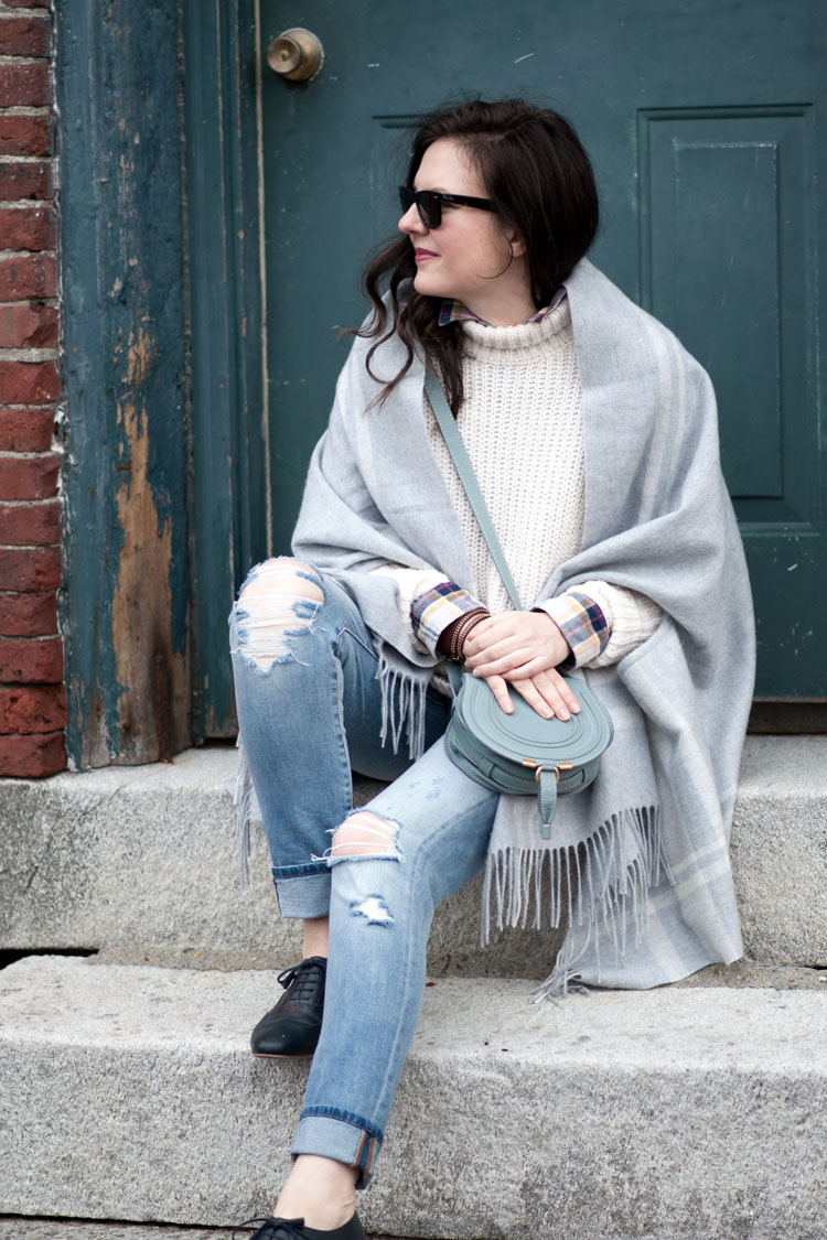 fall style ripped jeans chunky sweater and grey scarf