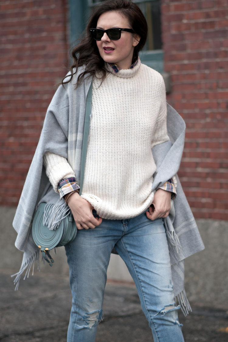 white chunky sweater and a poncho cape scarf from jcrew