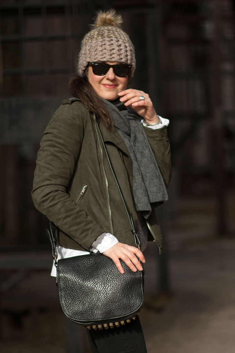 Style blogger layering chunky accessories with a suede moto jacket for a cool transitional weather outfit