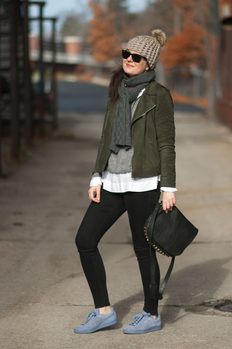 Dress like a style blogger with a suede moto jacket and black jeans, and layers
