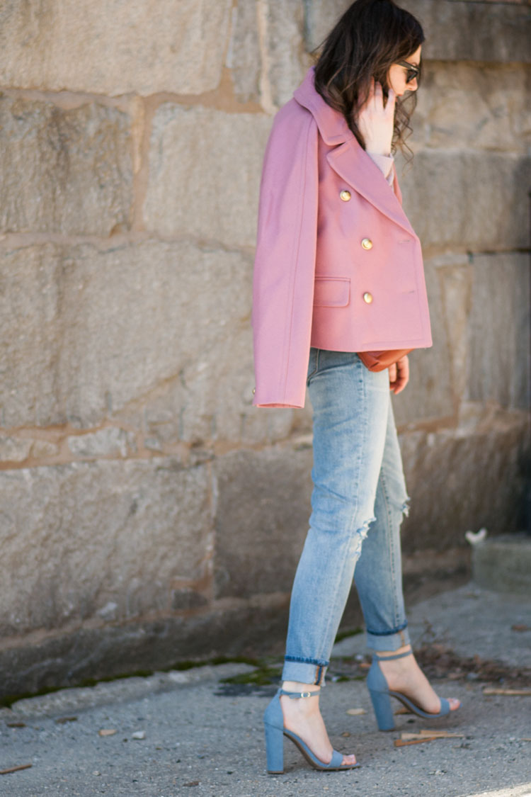 Styling a pink coat for spring with ripped jeans