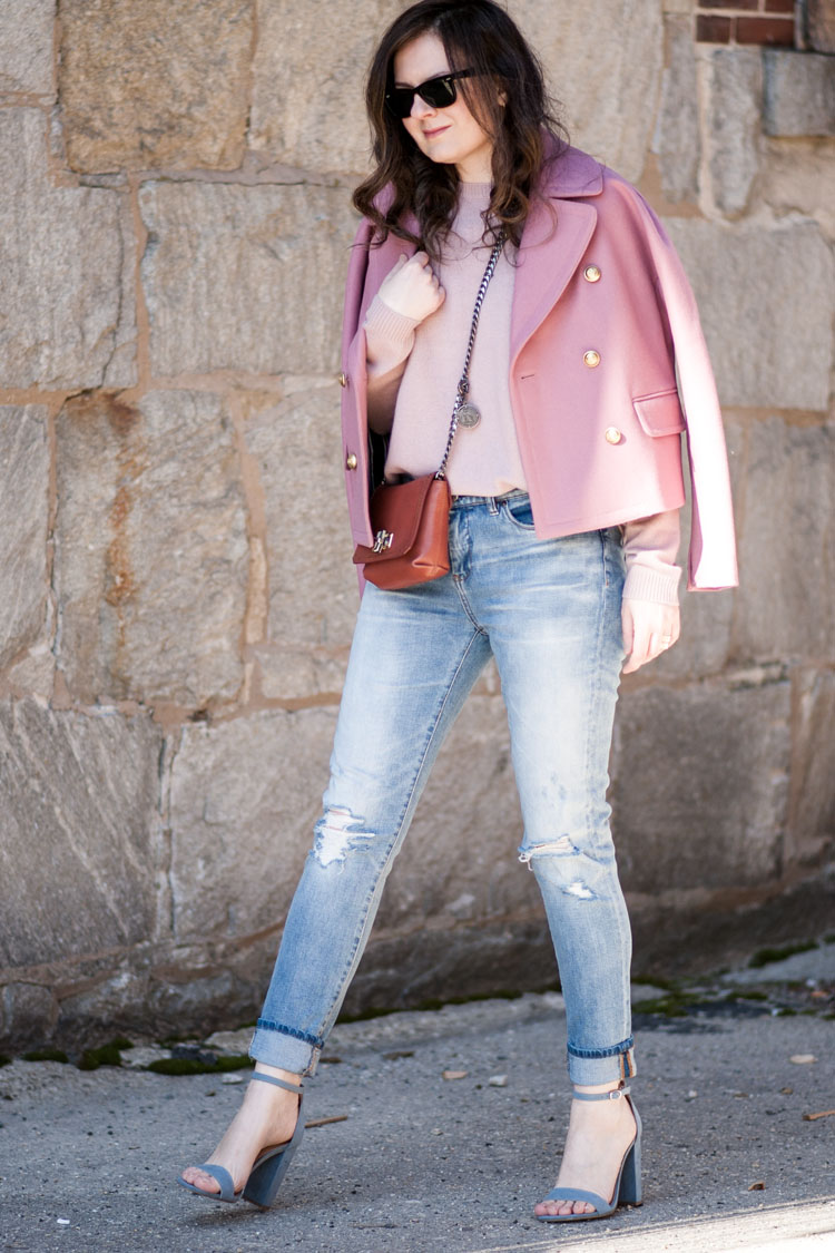 blogger spring street style with pink coat pink sweater and ripped jeans