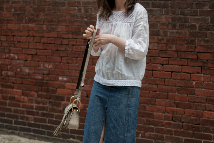 White shirt styled with a jeans skirt